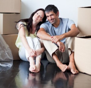 couple sitting on stained floor